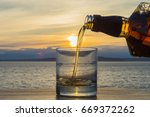 close up view pouring amber... | Shutterstock . vector #669372262