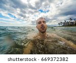 man taking selfie while... | Shutterstock . vector #669372382