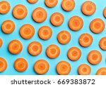 sliced carrot on blue color... | Shutterstock . vector #669383872