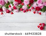 roses and red hearts on a... | Shutterstock . vector #669433828