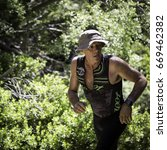 Small photo of Tahoe City, CA, USA - June 24, 2017: Troy Schroeder of Roseville, California, runs to first place in the male 50-54 age group at XTERRA Tahoe City.