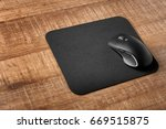 pad with computer mouse on... | Shutterstock . vector #669515875