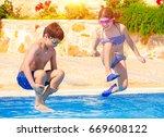 two happy children in the pool  ... | Shutterstock . vector #669608122