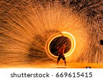 fire dancers swing fire dancing ... | Shutterstock . vector #669615415