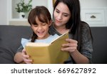 happy mother and daughter... | Shutterstock . vector #669627892