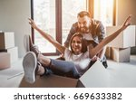 happy couple is having fun with ... | Shutterstock . vector #669633382