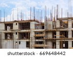 Small photo of Building that is being built, concrete and sticking fittings