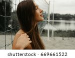model in swimsuit posing near... | Shutterstock . vector #669661522