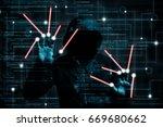 hooded hacker changes computer... | Shutterstock . vector #669680662
