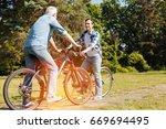 joyful easy going man and his... | Shutterstock . vector #669694495
