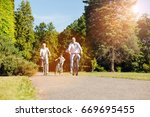 optimistic active family making ... | Shutterstock . vector #669695455