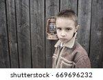 portrait of a handsome boy  | Shutterstock . vector #669696232