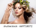 beautiful woman with long curly ... | Shutterstock . vector #669718072