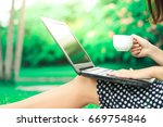 woman using a laptop while... | Shutterstock . vector #669754846
