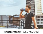 young man resting on the roof... | Shutterstock . vector #669757942