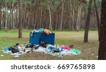 garbage in the park  ecology | Shutterstock . vector #669765898