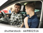 shot of a young boy talking to... | Shutterstock . vector #669802516