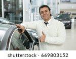 happy mature handsome man... | Shutterstock . vector #669803152