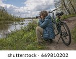 Small photo of Woman take pictures during the bicycle tour