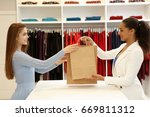 gorgeous young woman buying... | Shutterstock . vector #669811312