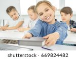 adorable young girl smiling... | Shutterstock . vector #669824482