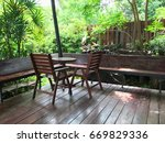wood chairs and table with... | Shutterstock . vector #669829336