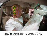 crash test dummies in a car... | Shutterstock . vector #669837772