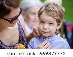 mother comforting son after... | Shutterstock . vector #669879772