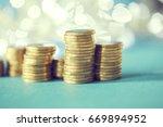 stacks of golden coins  euros  | Shutterstock . vector #669894952