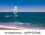 wind surfers on the blue sea | Shutterstock . vector #669920368