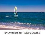 wind surfers on the blue sea | Shutterstock . vector #669920368