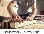 a young male carpenter builder...   Shutterstock . vector #669923785