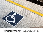 sign disabled people on the sky ... | Shutterstock . vector #669968416