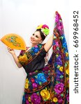 beautiful smiling mexican woman ... | Shutterstock . vector #669968452