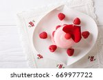 pink macaroon with raspberry... | Shutterstock . vector #669977722