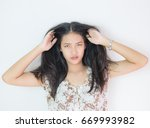 women have itchy scalp fungus. | Shutterstock . vector #669993982