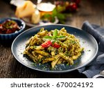 penne pasta with spinach and... | Shutterstock . vector #670024192