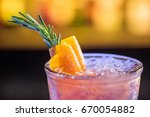 pink cocktail on the bar | Shutterstock . vector #670054882