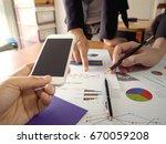businessmen use the smart phone ... | Shutterstock . vector #670059208