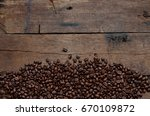 coffee beans on wood background | Shutterstock . vector #670109872