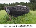 old fishing ship on the lake's... | Shutterstock . vector #670136326