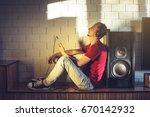 handsome man  a music lover... | Shutterstock . vector #670142932