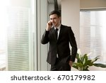young happy businessman talking ... | Shutterstock . vector #670179982