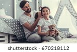 cute little daughter and her... | Shutterstock . vector #670218112