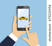 hands holding phone with taxi... | Shutterstock .eps vector #670225456