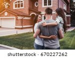 back view of happy family is... | Shutterstock . vector #670227262