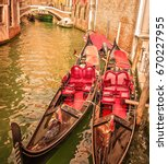 canal with two gondolas in... | Shutterstock . vector #670227955