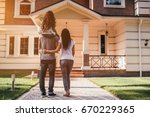 back view of happy family is...   Shutterstock . vector #670229365