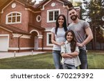 happy family is standing near... | Shutterstock . vector #670229392