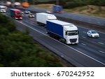lorries in motion. evening...   Shutterstock . vector #670242952